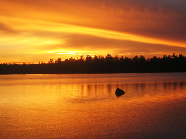 sunsetting across Lake Massabesic